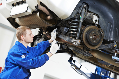 Certified Mechanic working on Calgary car at Change Auto